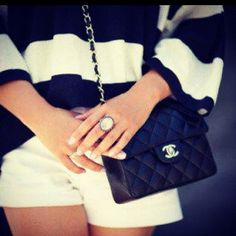 LOVE this purse. Channel does it best.