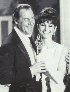 "Audrey Hepburn and Rex Harrison.  They starred together in the film version of, ""My Fair Lady"" in 1964.  He won the Academy Award for best actor in this movie."
