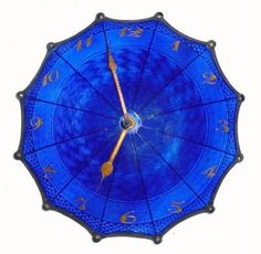 Antique Swiss clock (circa 1900) in cobalt blue Guilloche enamel over silver, with 24k Gold Numerals and Hands