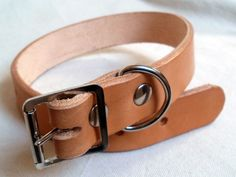 Natural handmade Leather dog collar, $12.00, via Etsy.