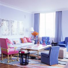 The Power of Pink: the perfect color to accent a periwinkle and purple Living Room. Interior Designer: Jamie Drake.