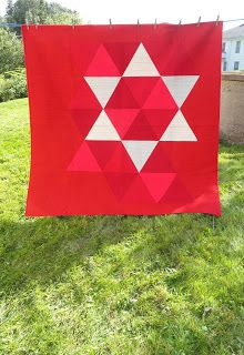 """A wonderful wedding gift, All Things Equal, was made by Michèle-Renée Charbonneau from Quilt Matters for a very special couple.  """"I went with matchstick quilting using red 50 wt. #Aurifil 2260 and red 40 wt. #Aurifil 1103. I was hoping that using two weights and shades of red would give a bit of depth to the quilting, but the reds I chose were really too close in colour and weight to really tell. Lesson learned.""""   http://quiltmatters.blogspot.com/2013/08/tgiff-all-things-equal.html"""