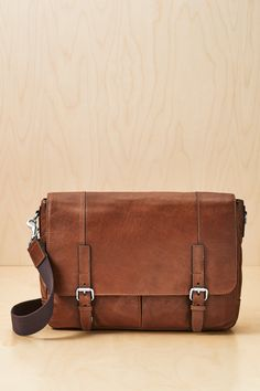 """A leather messenger with impeccable style? The Graham EW Messenger bag. It's also tech smart—this bag is large enough to hold laptops up to 15"""", Macbook® Pro and similar sized models."""