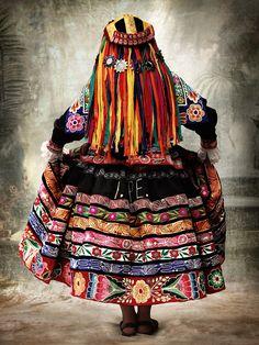 Peru | Cusco, 2007: Traditional women's dress. Province of Espinar | ©Mario Testino http://www.wholesaleperuvianjewelry.com/