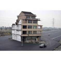 An elderly Chinese couple refused to sign an agreement allowing their house to be demolished for a new road .
