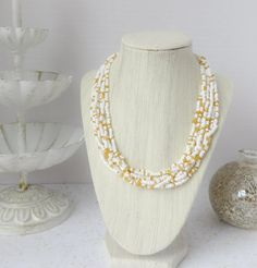 Multistrand white and gold beaded necklace by InstinctBoutique, $25.00