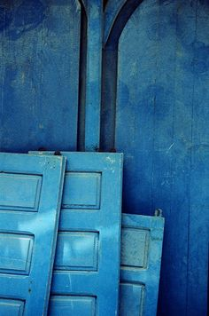 could use the beautiful blue aged doors to make a tall headboard! Or add the photo to the wall gallery...