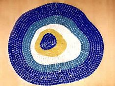 Evil Eye Mosaic..Great idea for the bottom of a pool...