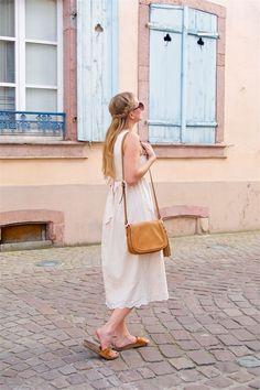Heartfelt Hunt - Romantic Pastel Colors - Romantic lace dress, sunglasses, tassel bag, sandals and a braided half-up half-down hairstyle