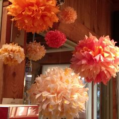 DIY hanging tissue paper flowers in a corner to add some color