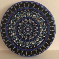This is a dot art mandala painted on an 8 pine round using acrylic paint. It is sealed with a semi-gloss clear coat varnish. My mandalas are all created intuitively. This is a one-of-a-kind original. No prints will be made from it and it cannot be duplicated. It can be used as wall Clock Painting, Dot Art Painting, Mandala Painting, Stone Painting, Mandala Canvas, Mandala Art, Aboriginal Dot Art, Painted Rocks, Hand Painted