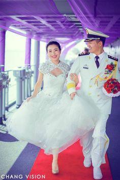 White uniform & white dress: group wedding on Chinese warship.