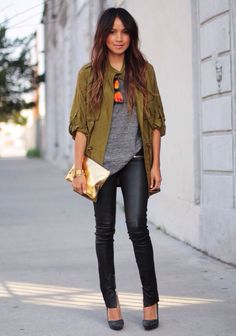 Womens street style fashion by Sincerely Jules: army green jacket, grey tshirt, black wet look jeanz, polarised sunglasses, gold leather clutch bag