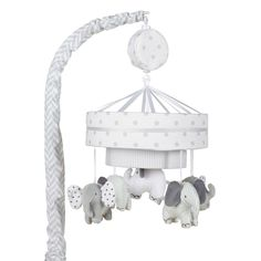 Just Born Hattie & Ellie Musical Mobile helps to soothe your baby to sleep while gently spinning and playing a lullaby. Fits onto most standard and convertible cribs. Features elephants spinning gently and coordinates beautifully with the entire Hattie & Ellie nursery collection. (sold separately)
