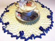Crochet doily Holliday doily blue ribbon yellow blue.