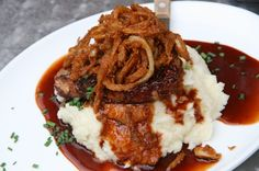 The Bacon Wrapped Meatloaf – Mashed Potatoes, Port Wine Sauce, Crispy Onion Rings – at Wolfgang Puck Express, Walt Disney World!