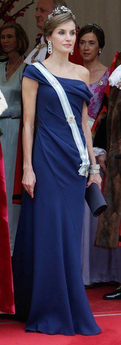 Carolina Herrera sapphire blue asymmetric off-the-shoulder draped gown