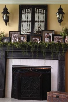 mantle decor | Mantel decor | home stuff Love the greenery & the fireplace screen.