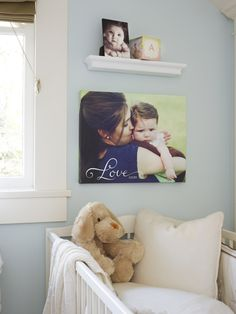 Stay close to your baby with photos around his/her nursery. Canvas prints, photo cubes and desktop plaque from Shutterfly  I like the idea of a family pic in the kids room