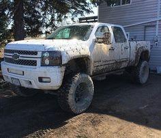 lifted Chevrolet Silverado truck white
