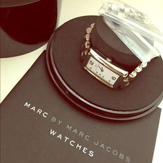 Marc by Marc Jacobs Watch Authentic Marc by Marc Jacobs silver stainless steel bracelet 6 1/4 inches around wrist approximately. Comes with extra links (previously removed links) and instruction booklet. Original box included. A little scratches on it but nothing major or damage. Preloved in excellent used condition. In perfect working order (a new battery has just been fitted). Marc by Marc Jacobs Accessories Watches