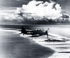 SBD-5 from USS Lexington (CV 16) over Majuro Atoll. Photograph released May 13, 944. Official U.S. Navy photograph, now in the collections of the National Archives.
