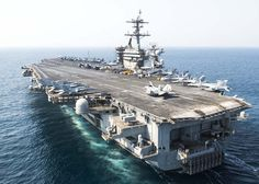 151002-N-SB299-456 ARABIAN GULF (Oct. 2, 2015) The aircraft carrier USS Theodore Roosevelt (CVN 71) transits the Arabian Gulf. Theodore Roosevelt is deployed in the U.S. 5th Fleet area of operations supporting Operation Inherent Resolve, strike operations in Iraq and Syria as directed, maritime security operations and theater security cooperation efforts in the region. (U.S. Navy photo by Mass Communication Specialist Seaman Alex Millar/Released)