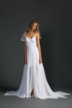 With a unique, timeless silhouette and a combination of wildly romantic elements, the Hollie is without a doubt the signature GLL gown.