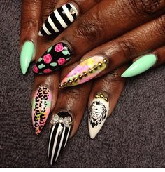 Stiletto nails -.love the lion! Very punk. I'll be trying these soon..,  -BNM2013