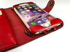All-leather iPhone 7 wallet case that allows access to all functions of your iPhone without using a plastic bumper to hold the phone. Entirely hand-stitched.