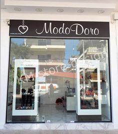 Η KM store designέφερε εις πέρας την Επίπλωση ΚαταστήματοςΦο-Μπιζού στην Άνω Γλυφάδα. Το κατάστημα ονομάζεται Modo Doroκαι μεριμνήθηκε ο σχεδιασμός και η κατασκευή επαγγελματικών επίπλων, τα οποία να αναδεικνύουν τα αξεσουάρ που πωλούνται σε αυτό. Για αυτό το σκοπό, επιλέχθηκαν λιτά και συνάμα κομψά έπιπλα με μοντέρνο design και Vanity, Stainless Steel, Mirror, Store, Furniture, Home Decor, Dressing Tables, Powder Room, Tent