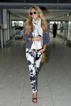 Elle Macpherson's tie-dye jeans and boho-cool layers made for a fresh airport look.