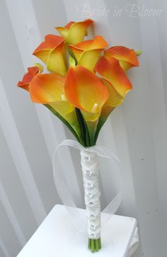 Calla lily Wedding bouquet orange real touch Bridal bouquet & boutonniere. $60.00, via Etsy.