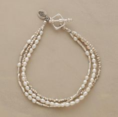 ENCOUNTERS BRACELET--The luster of cultured pearls meets the glimmer of pure Thai silver. A handcrafted exclusive. 3 strands