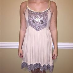 Free People Sundress Oh my goodness, this is one of the softest dresses I've ever owned and it is absolutely adorable. Perfect for hotter days or cooler spring/summer nights with a cute cardi! In wonderful condition and from a smoke free home  Free People Dresses Midi