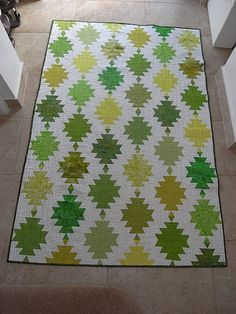 Chinese lanterns or magic lanterns quilt as inspired by Lynne Edwards Making scrap quilts to use it up. See another picture for the jazzy batik pieced back