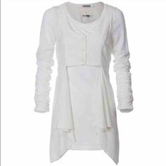 coming soon  Wonderful tunic, with vest like button on front. Back gold tab. Longer on the sides . This summers in color white Monoreno Tops Tunics
