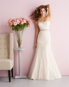 #Allure 2703: Lacy and feminine, this strapless gown features a Swarovksi crystal belt and a chapel length train. Low back and lace over sweetheart neckline.