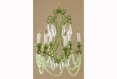 "Katherine's Collection Green Miniature Chandelier. 6"" x 4.75"" Great accessory for any room. Handcrafted with beads & glitter Texture differences may appear on this handcrafted item are inherent to the"