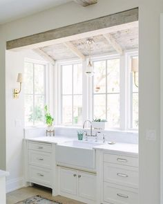 Charming modern farmhouse sink bay in a kitchen with rustic wood ceiling and design by Kate Marker in Barrington IL. Charming modern farmhouse sink bay in a kitchen with rustic wood ceiling and design by Kate Marker in Barrington IL. Home Design, Küchen Design, Sink Design, Design Ideas, Interior Design, Home Decor Kitchen, New Kitchen, Kitchen Sink, Kitchen Ideas