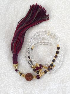 A personal favorite from my Etsy shop https://www.etsy.com/listing/223707685/pure-crystal-quartz-and-garnet-108-bead