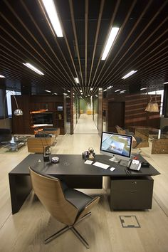 Great space for a modern office, love the open concept and the light flooring (of course)