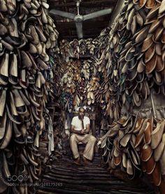 Shoes maker Handmade shoes maker smoking shisha.