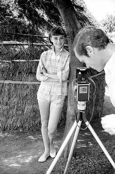 Audrey Hepburn being photographed by her husband Mel Ferrer