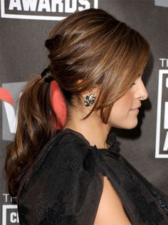 Make a classic '60s-style bouffant modern by placing it in an ultrashiny ponytail, like Eva Mendes did at the Critics' Choice Awards.