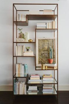 Gorgeous etagere styling. Turn the books spines out to keep a cohesive color palette.