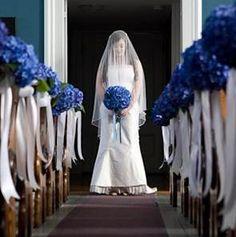 church pew decor with light blue hydrangea www.myfloweraffair.com can create this beautiful wedding flower look.