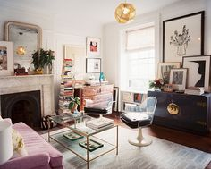 Wonderful eclectic living room with lucite chairs and a navy lacquered credenza and pink couch--image via Metsa For House
