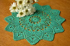 New hand-crocheted doily. This beautiful, lacy doily would be an elegant centerpiece, a lovely accent for your home. Color: green. Please note that colors shown may vary depending on your monitor settings. Material: 100% mercerized cotton. Size approximately: 12 in (30 cm). Instructions for care: Gently hand wash using mild liquid soap and lukewarm water. Roll them in a towel to remove excess water. Spread out on a dry towel, reshape and leave to dry. Use iron steam to remove any wrinkles...