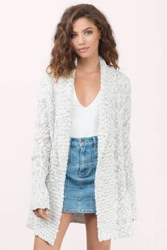 Cream knit cardigan that'll keep you warm and fashionable.